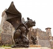 foto of gargoyles  - A gargoyle sits along side of his twin in front of the castle that they guard - JPG