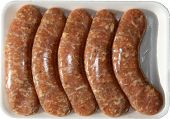 stock photo of grilled sausage  - Fresh Raw Chicken Sausages in their package from the butcher shop - JPG
