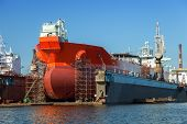 foto of shipyard  - A large tanker repairs in dry dock - JPG