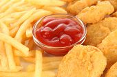 foto of grease  - Fried chicken nuggets with french fries and sauce isolated on white - JPG