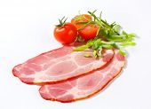thin sliced of pork neck with vegetable and herbs