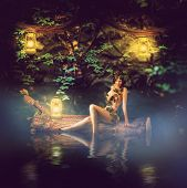 stock photo of kerosene lamp  - Fantasy fairytale beautiful woman  - JPG