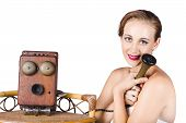 foto of long distance relationship  - Cute vintage woman hungging antique telephone with a longing expression - JPG