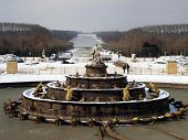 pic of versaille  - fountain in the garden of the royal residence at Versailles near Paris in France in the winter scenery the snow - JPG