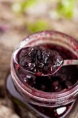 picture of jar jelly  - Jar of blueberry jam and some fresh berries - JPG