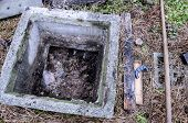 stock photo of manhole  - Septic tank in desperate need of emptying - JPG