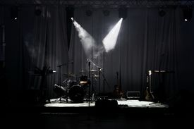 picture of string instrument  - Stage in Lights before concert - JPG