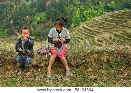 Asian Children In Mountains Of China, Among The Rice Terraces.