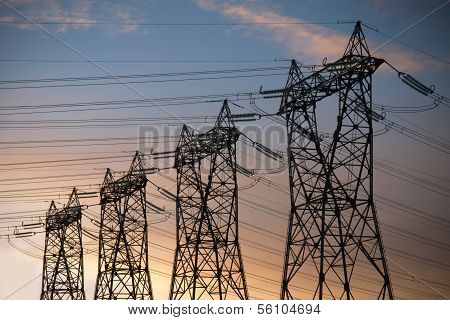 high voltage pylons silhouette