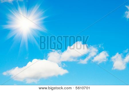 Blue Sky With Fun Sun And Clouds.