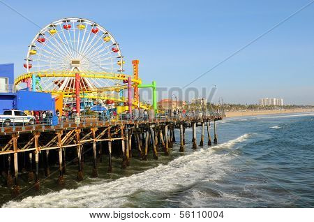 SANTA MONICA, CA - March 13, 2011:  The Ferris Wheel at Santa Monica Pier. The pier and its attractions are a popular destination for tourists and locals.