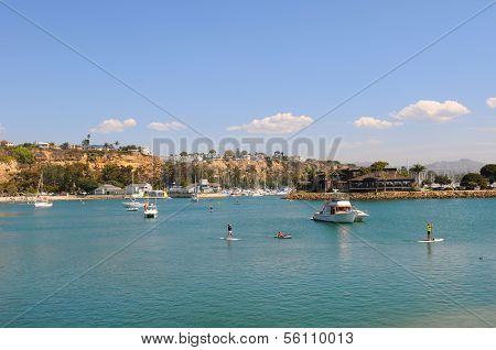 DANA POINT, CA - October 5, 2012:  Paddle Boarders and boats in Dana Cove, Dana Point, California. Paddle Boarding is a popular Southern California pastime.