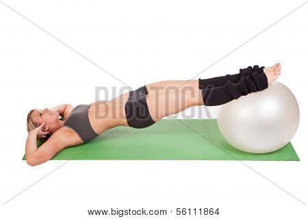 A beautiful young woman doing exercise on a fitness ball