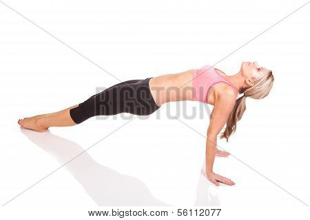 Portrait of pretty young woman doing yoga exercise