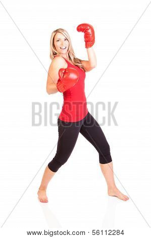 A beautiful young woman ready for a boxing exercise