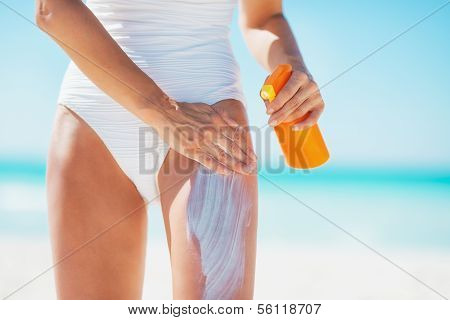 Closeup On Young Woman Applying Sun Block Creme On Beach