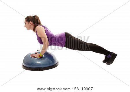 Athletic Woman Doing Pushups On A Bosu Ball