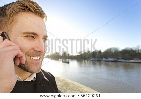 Handsome Man using his phone on a sunny day