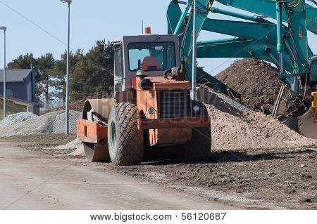 Excavators And Asphalt Compactor Truck