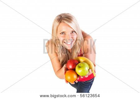 Head shot of woman holding fruit and water against white background