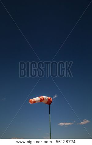 Wind Old Sock Against A Blue Sky