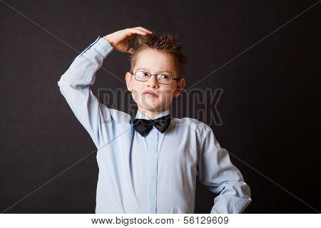 Boy  scratching his head thinking