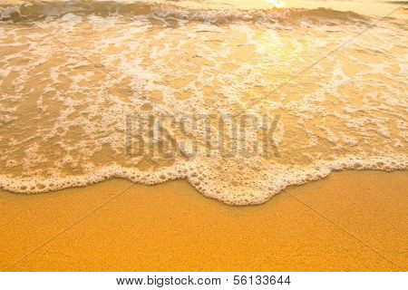 Beach sand texture, soft wave of the sea.