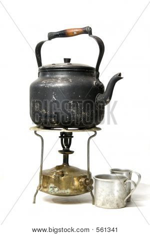 Old Smoked Teapot On A Kerosene Stove