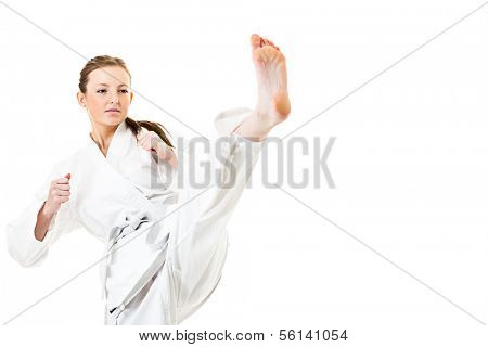 Beautiful caucasian, young, woman makes a kick in kimono on white background