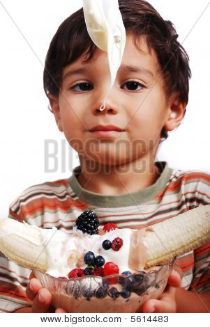 Very Cute Kid Is About To Eat Very Sweet Mixed Fruint And Cream