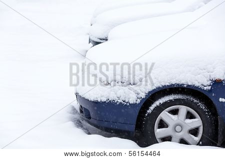 Cars in fresh snow