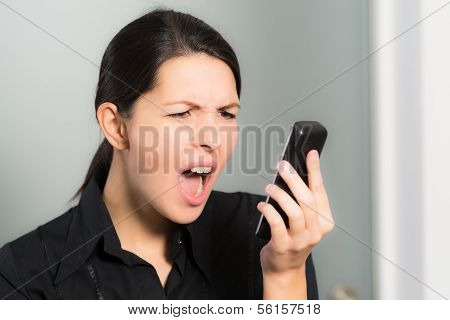 Woman Screaming While Looking At Her Mobile Phone