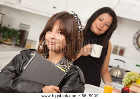 Attractive Hispanic Proud Mom With Her Pretty Schoolgirl Daughter