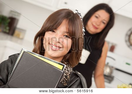 Attractive Hispanic Proud Mom With Her Pretty Schoolgirl Daughter