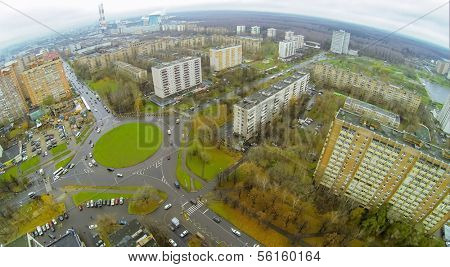 District with road roundabout on green square, view from unmanned quadrocopter.