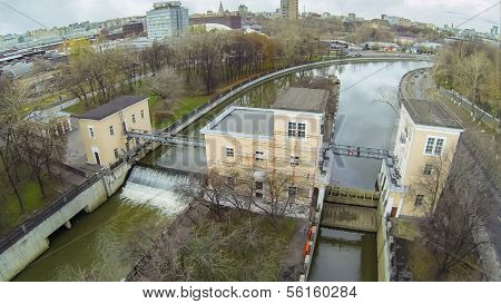 Small waterfall in Yauza river with two sluices of Syromyatnicheskiy waterworks, view from unmanned quadrocopter.