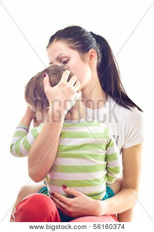 Mother calms a crying child