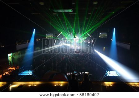 Crowd have fun on dancefloor with many colored spotlights