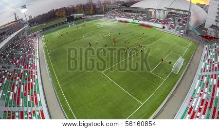 MOSCOW - OCT 17: View from unmanned quadrocopter to Small Sports Arena stadium Locomotive with football players and empty seats, on October 17, 2013 in Moscow, Russia.