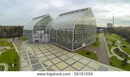 MOSCOW - OCT 23: View from unmanned quadrocopter to futuristic glass building of Main Greenhouse Botanical Garden with green lawns on October 23, 2013 in Moscow, Russia.
