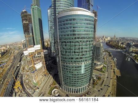 MOSCOW - OCT 12: Cityscape with towers of Moscow City, construction buildings near them and river (view from unmanned quadrocopter) on October 12, 2013 in Moscow, Russia.