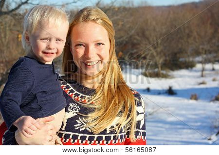 Happy Mother And Baby Outside In Winter