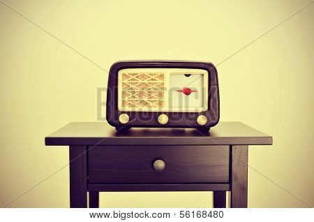 picture of an antique radio receptor on a desk, with a retro effect