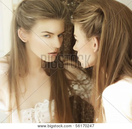 Delusion. Image Of Beautiful Woman In Front Of A Mirror