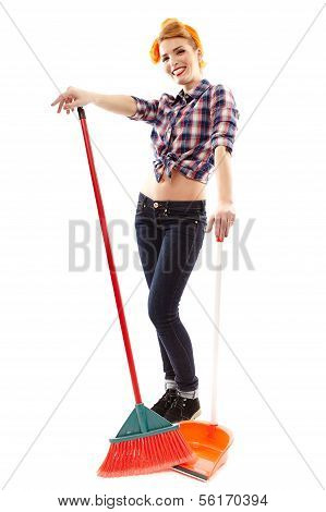 Cheerful Housewife With Broom And Dustpan