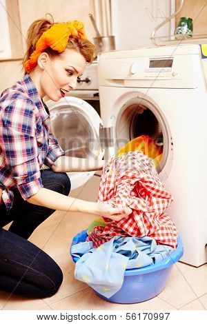 Housewife Putting The Laundry Into The Washing Machine