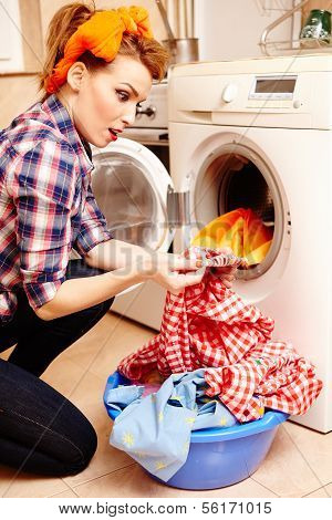 Housewife Spotting A Stain On The Laundry