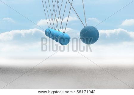 Newtons cradle above desert