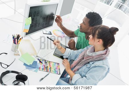 High angle view of two artists working on computer at the office