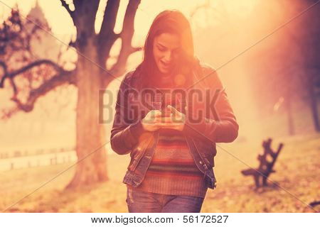 girl using mobile phone outdoor retro colors